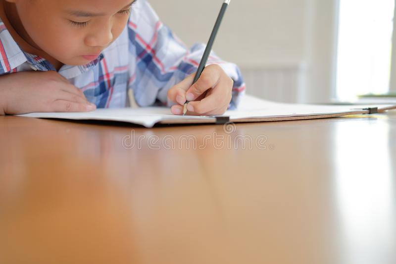 asian kid boy child schoolboy drawing picture. children activity stock images