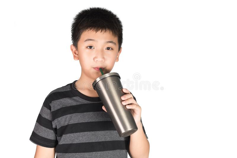 Asian kid boy holding stainless steel tumbler cup with straw, is royalty free stock images