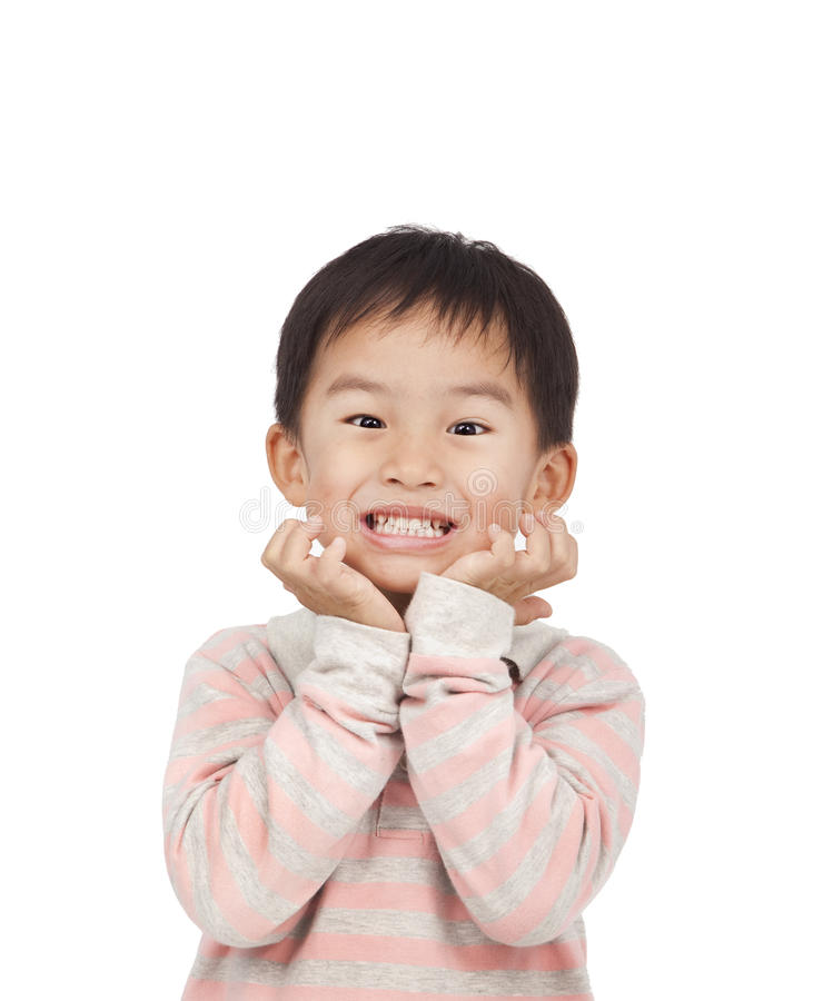 Asian kid expressing surprise. With his hands in his face royalty free stock image