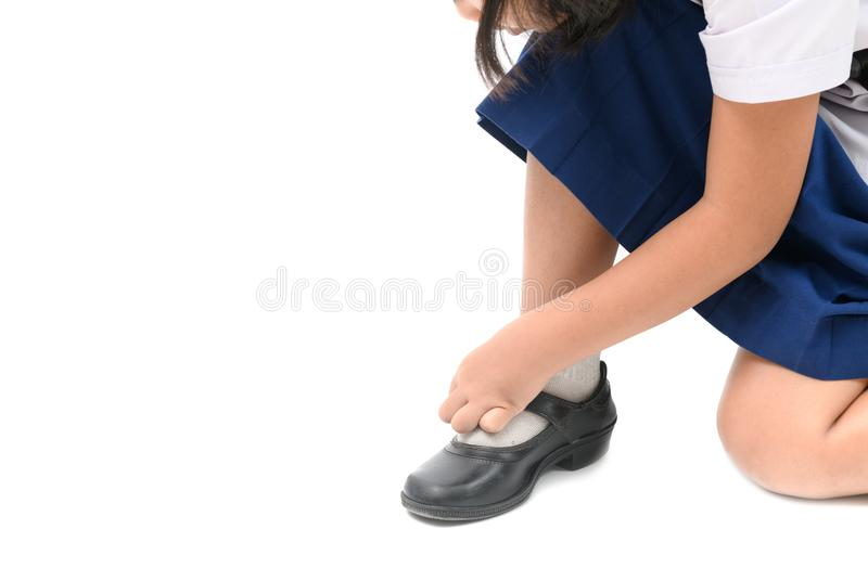 Asian kid girl lacing student shoes isolated royalty free stock photos