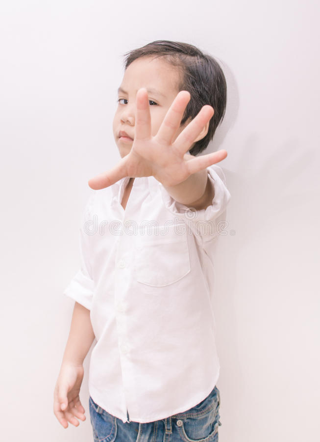 asian kid and hand raise stop written royalty free stock image