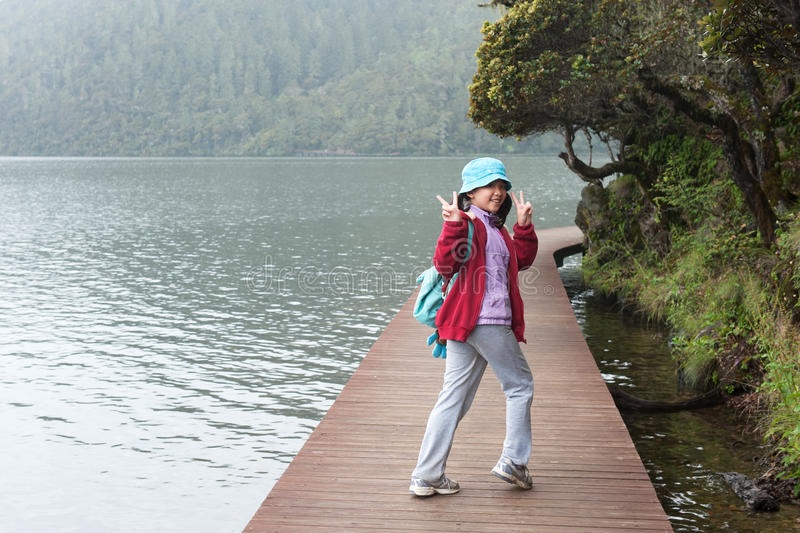Asian kid hiking stock images