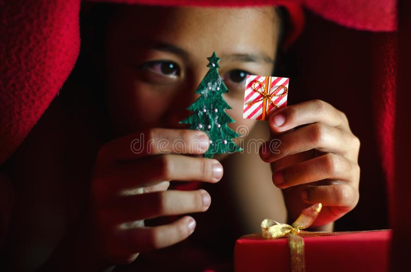Asian kid hold gift box icon. royalty free stock photography