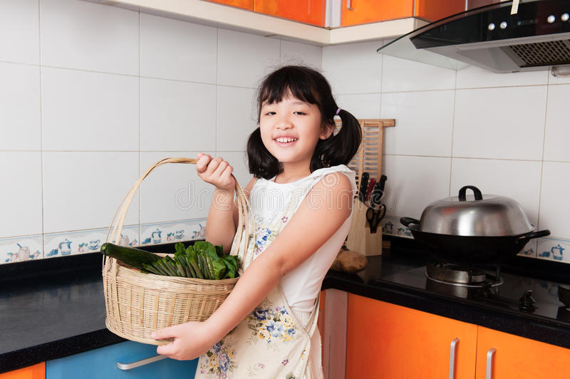 Asian kid in kitchen royalty free stock photo