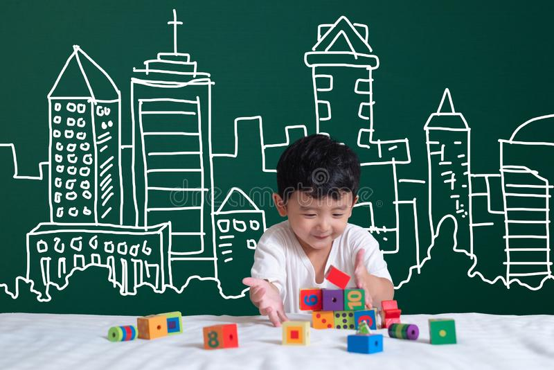 Asian kid learning by playing with his imagination about building and engineer architecture drawing and designer, hand drawn on t stock images