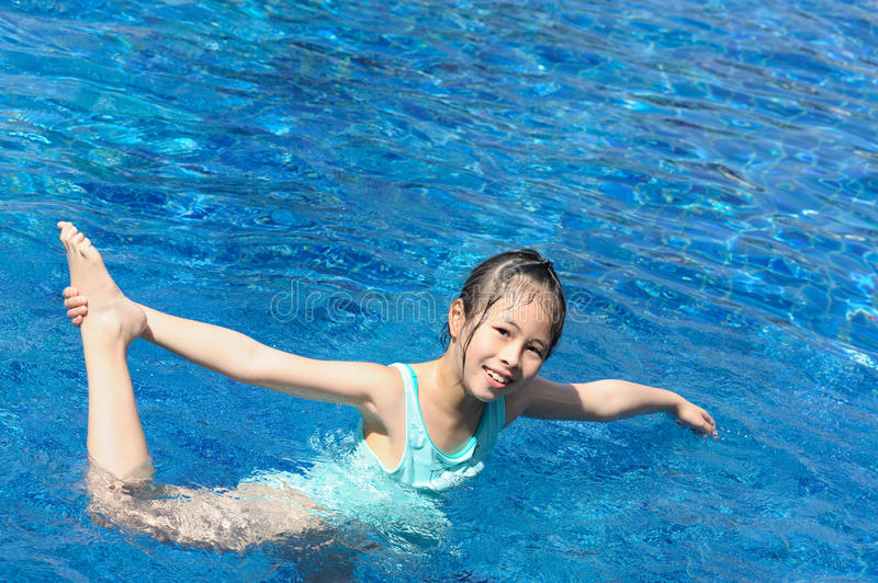 Download Asian Kid Playing In Swimming Pool Stock Photo - Image: 18253834