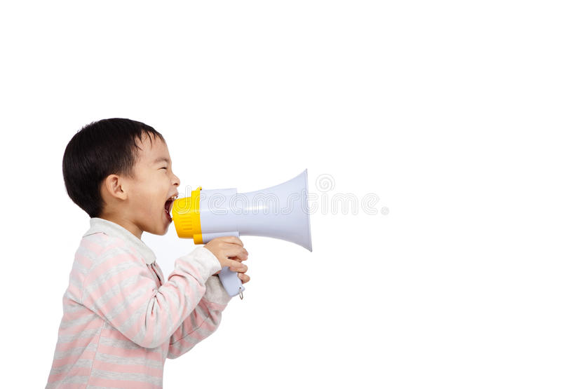 Asian kid shouts something by megaphone. Asian kid shouts something into the megaphone royalty free stock photos