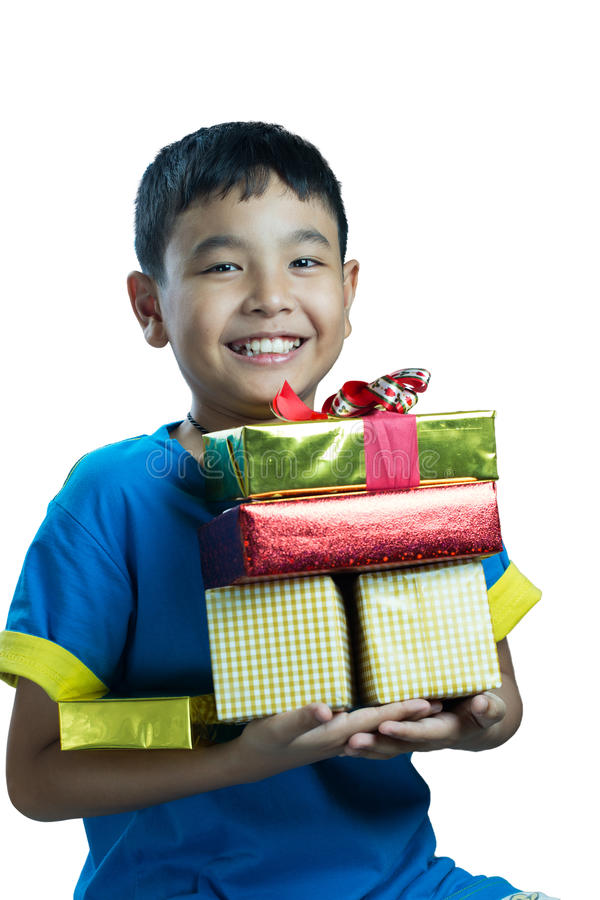 Asian kid smile holding stack of presents boxes stock images