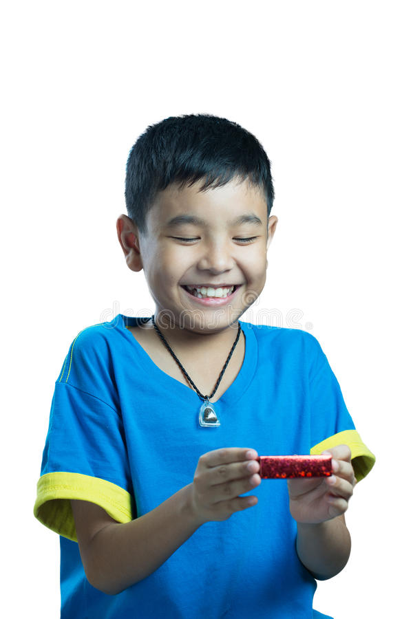 Asian kid smile receive Christmas gift stock photo