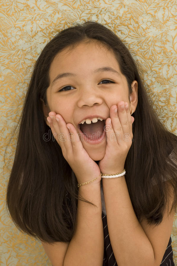 Download Asian Kid With Surprised Expression Stock Image - Image of paper, girl: 10644361