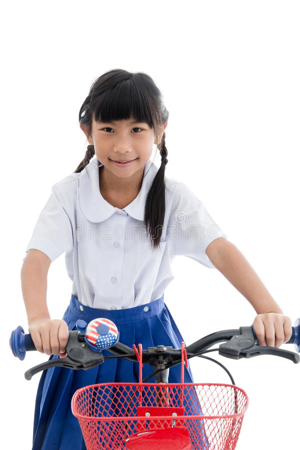 Asian kids cute girl in student's uniform riding royalty free stock image