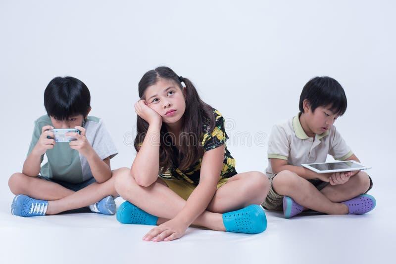 Asian kids playing tablet stock photos