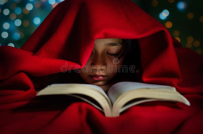 Asian Kids Sleeping with Book on the Bed stock images
