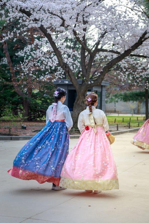 Free Asian Korean Woman Dressed Hanbok In Traditional Dress Walking In Gyeongbokgung Palace Stock Photos - 114182303