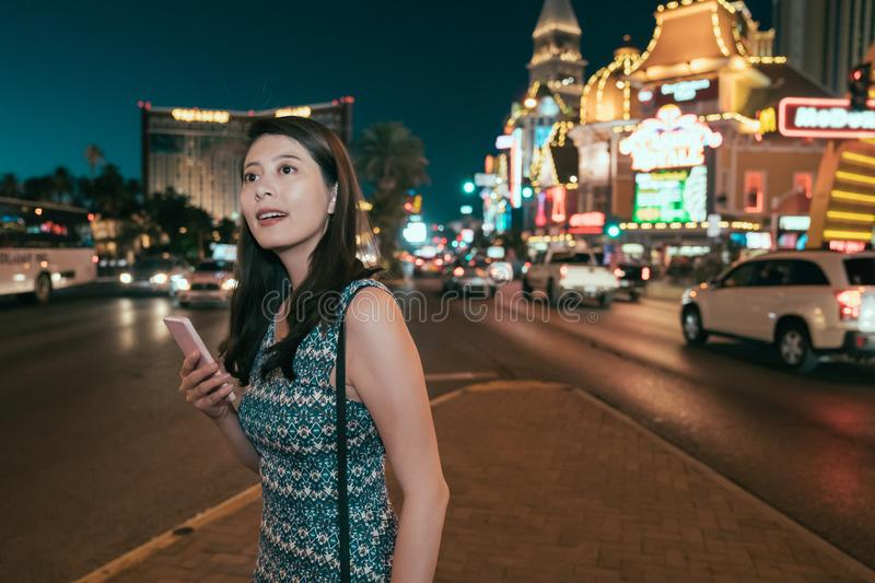 Asian lady on mobile standing with dark sky royalty free stock photos