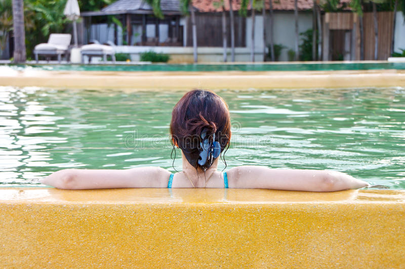A asian lady relaxing in swimming pool royalty free stock photos
