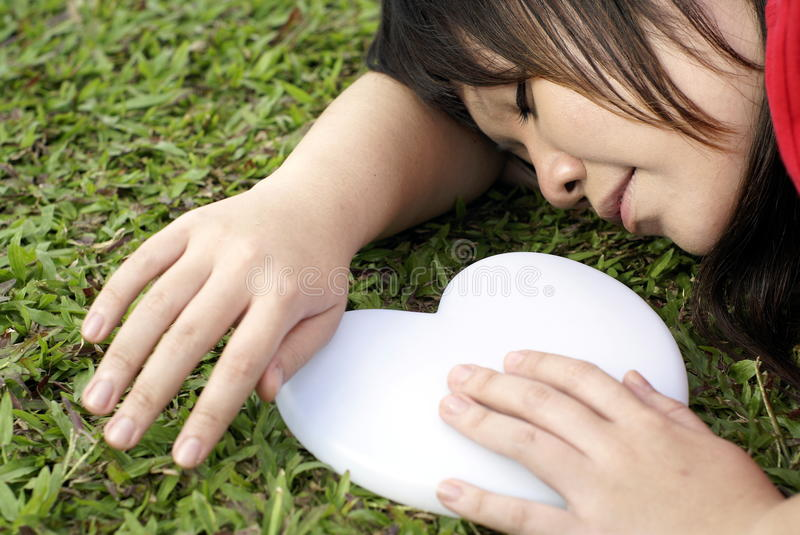 Asian lady sleep with white heart
