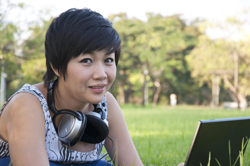 Download Asian lady using computer stock image. Image of young - 22530521