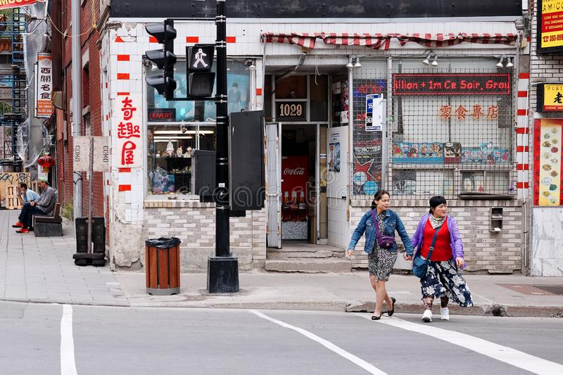 Asian lgbt female couple trying to cross the street hand in hand in Chinatown royalty free stock photography