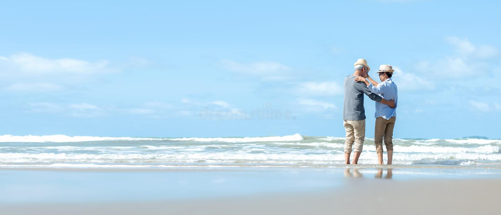 Asian Lifestyle senior couple dancing on the beach happy and relax time.  Tourism elderly family travel leisure and activity after stock images