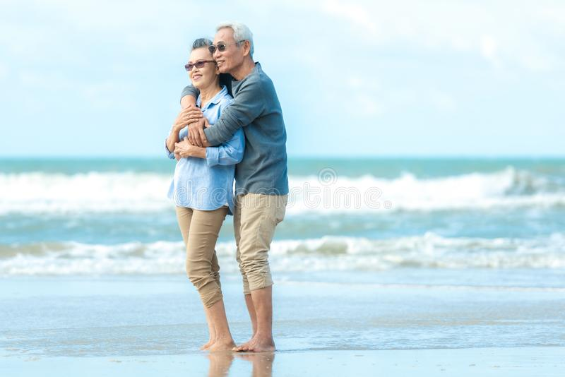 Asian Lifestyle senior couple hug on the beach happy in love romantic and relax time.   Tourism elderly family travel leisure and activity after retirement stock photos