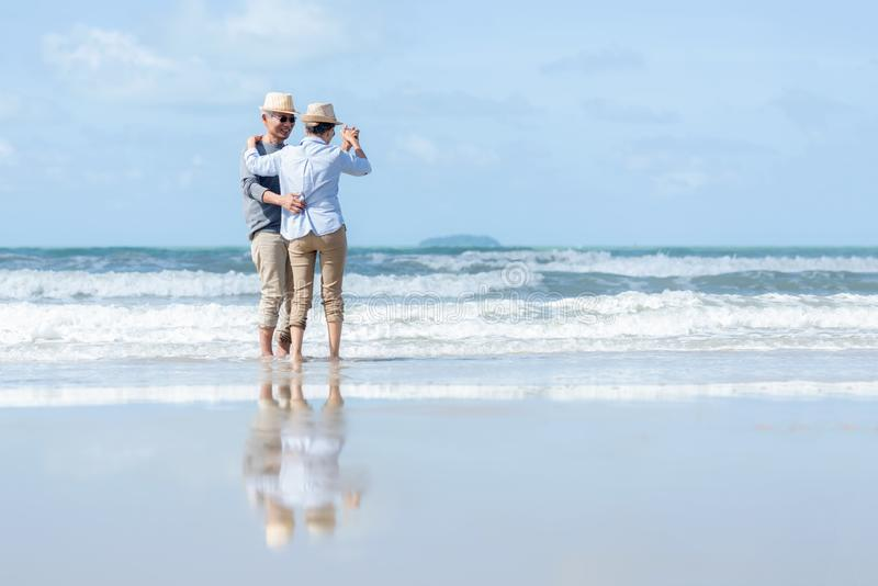 Asian Lifestyle senior elderly couple dancing on the beach happy enjoy in love romantic and relax time.  Tourism elderly family tr royalty free stock photos