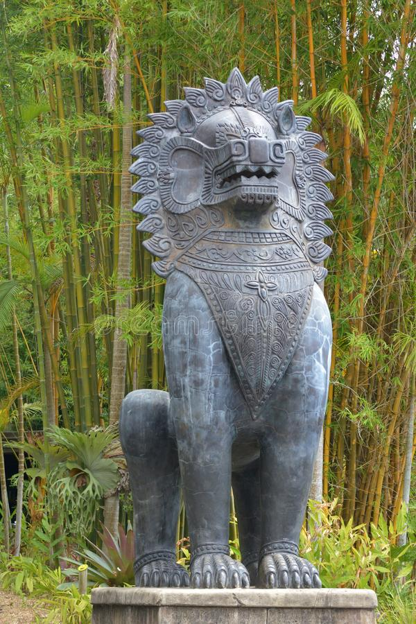 Asian lion guard sculpture outdoors royalty free stock photo
