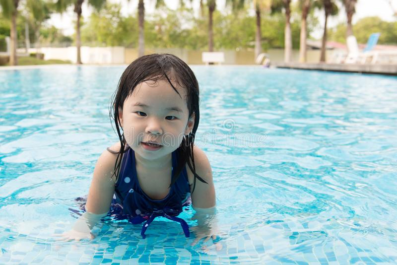 Asian little baby girl in swimming pool. Portrait of Asian little baby girl playing in swimming pool stock images