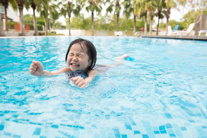 Asian little baby girl in swimming pool. Portrait of Asian little baby girl playing in swimming pool royalty free stock image