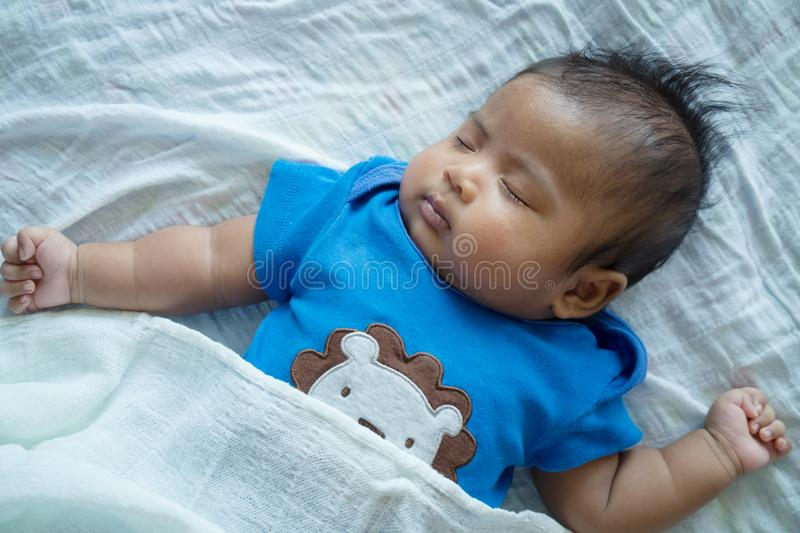 Asian little baby sleeping royalty free stock images