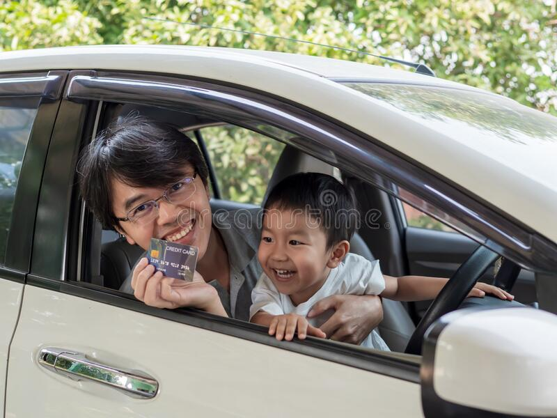 Asian little child boy and father inside car with happy smiling face. royalty free stock photo