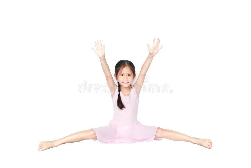 Asian little child girl dancer ballet ballerina stretching isolated on white background. Beautiful children in pink tutu skirt stock images