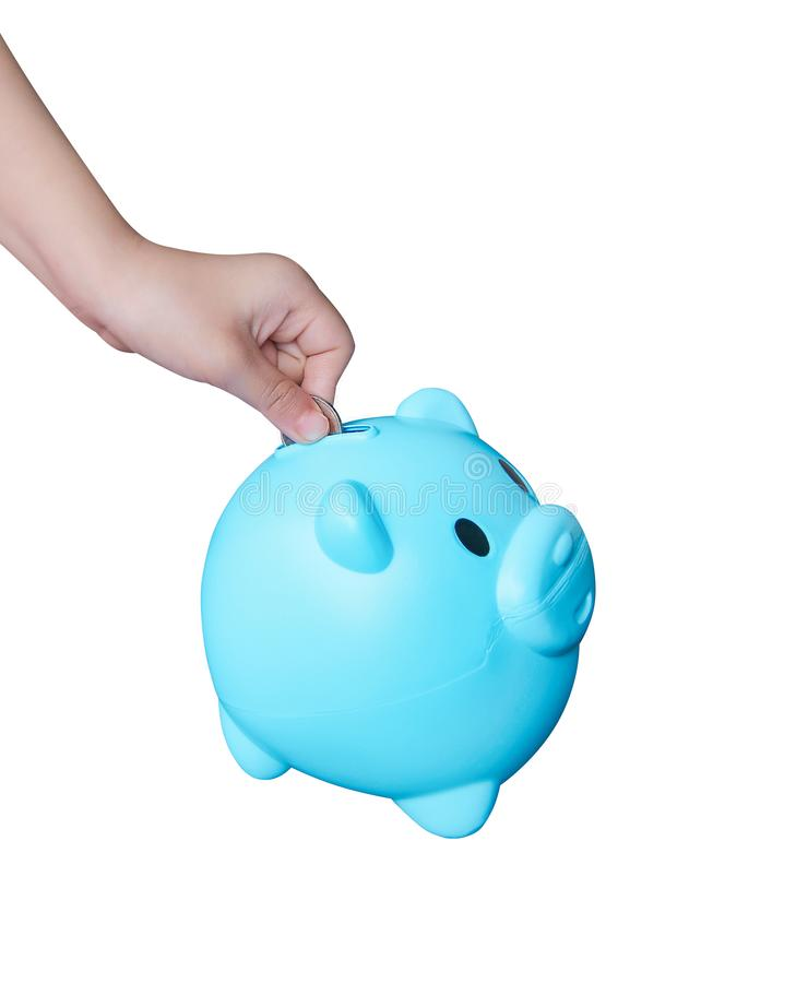 Asian little child hand putting coin in blue piggy bank or colorful empty money savings box isolated on white background with. Close up Asian little child hand stock photos