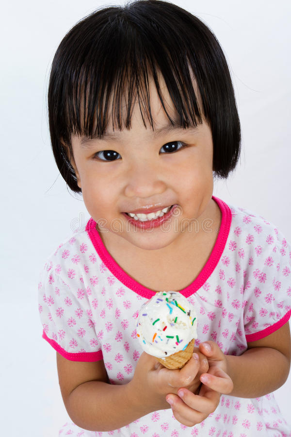 Asian Little Chinese Girl Eating Ice Cream royalty free stock photography