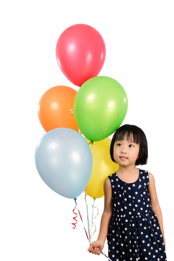 Asian Little Chinese Girl Holding Colorful Balloons stock image