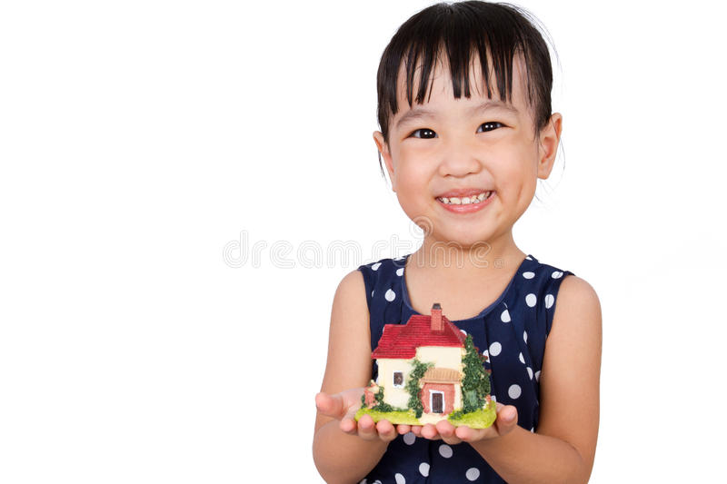 Asian Little Chinese Girl Holding Toy House for Property Concept. Isolated on White Background royalty free stock image