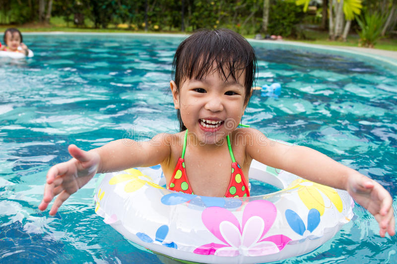 Asian Chinese Little Girl Child Playing Inside Swimming