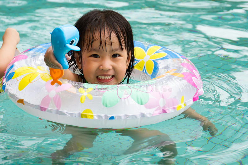 Cute asian little girl playing in the pool by ChaoShu Li