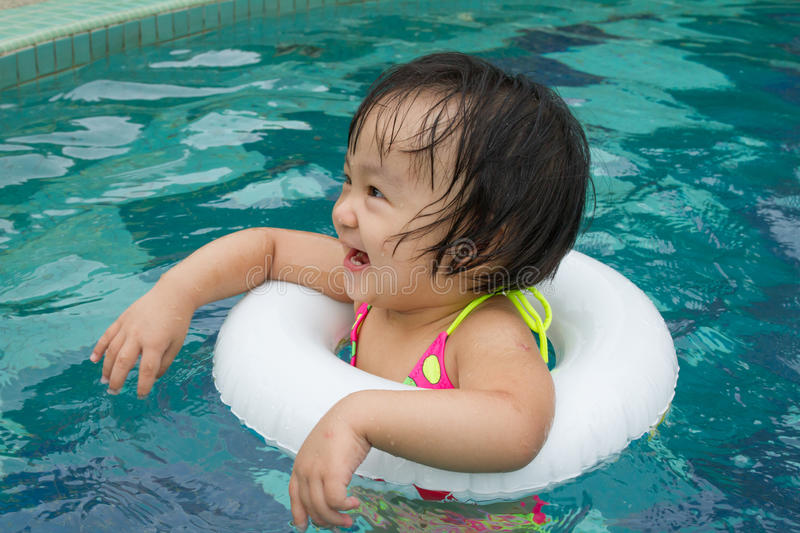 Asian Little Chinese Girl Playing In Swimming Pool Stock