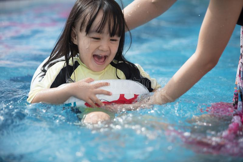 Asian Chinese Little Kids Playing In The Swimming Pool