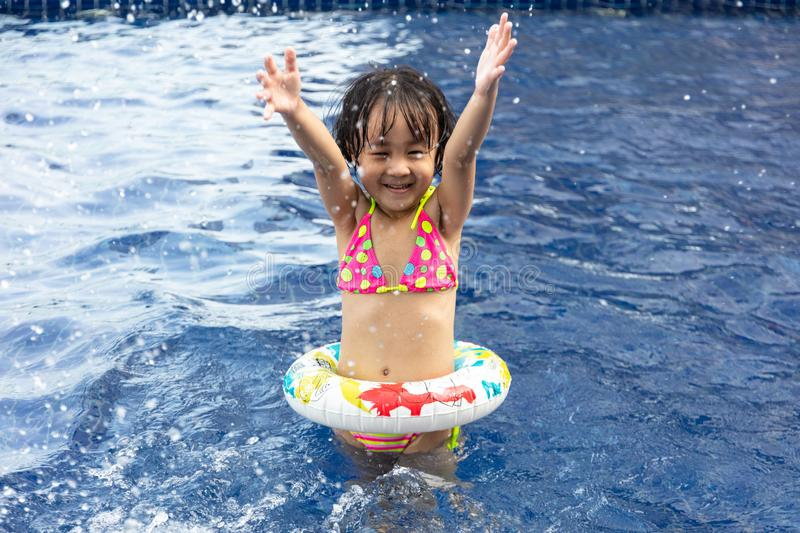 Asian Little Chinese Girl Playing in Swimming Pool royalty free stock images