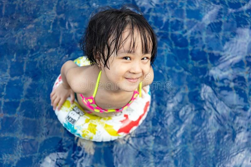 Asian Little Chinese Girl Playing in Swimming Pool stock photography