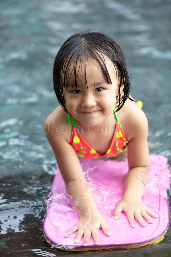 Asian Little Chinese Girl playing at water park stock images
