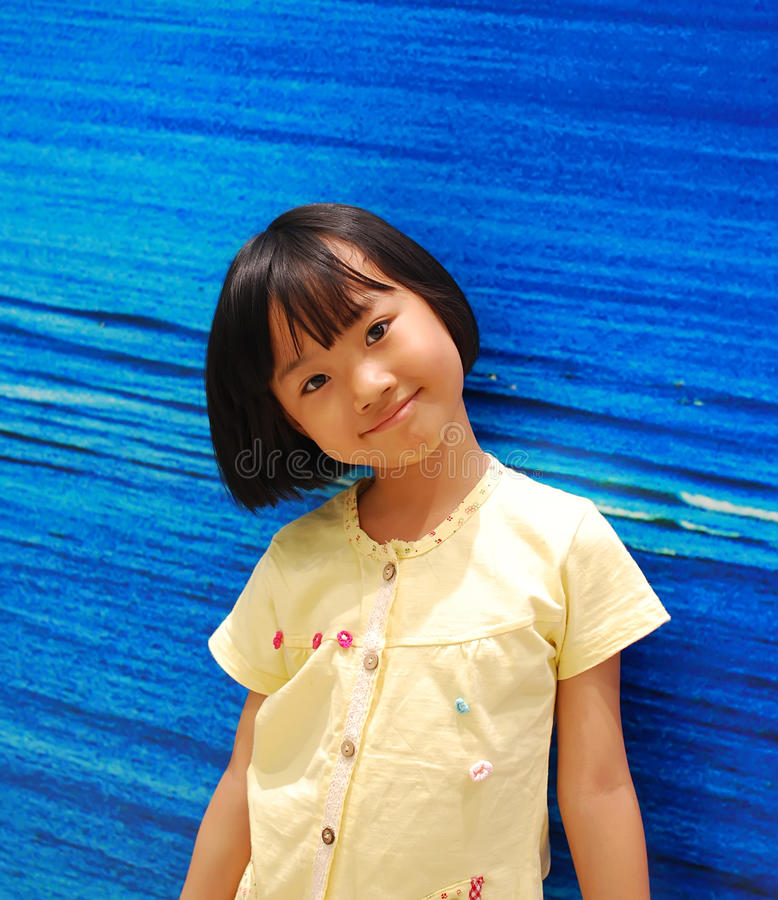 Download Asian Little Girl On Blue Background Stock Image - Image: 25148205