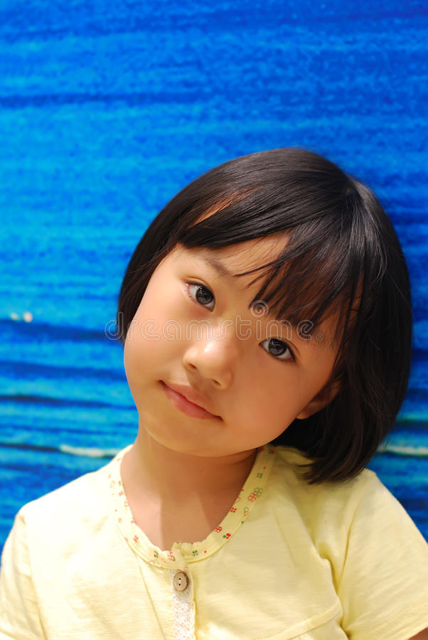 Download Asian Little Girl On Blue Background Stock Photo - Image of lovely, happy: 25148248