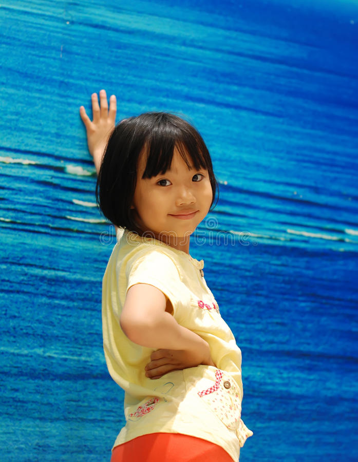 Download Asian Little Girl On Blue Background Stock Image - Image: 25253177