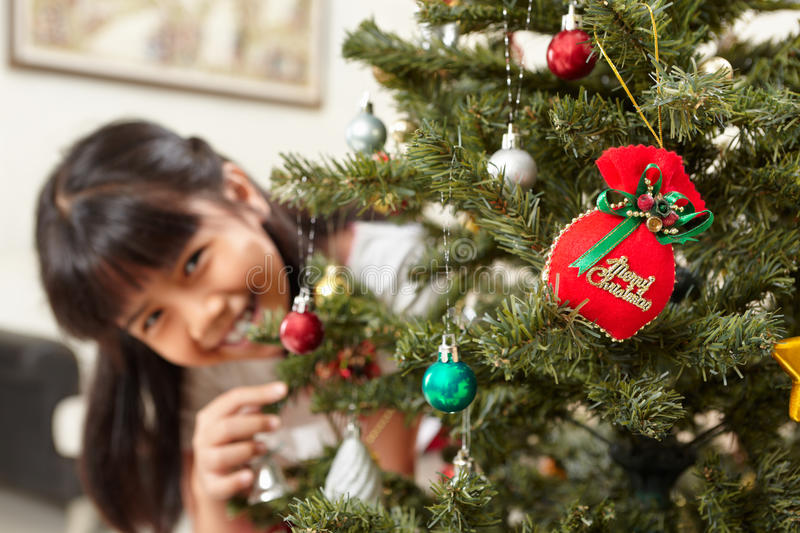 Asian little girl and Christmas tree