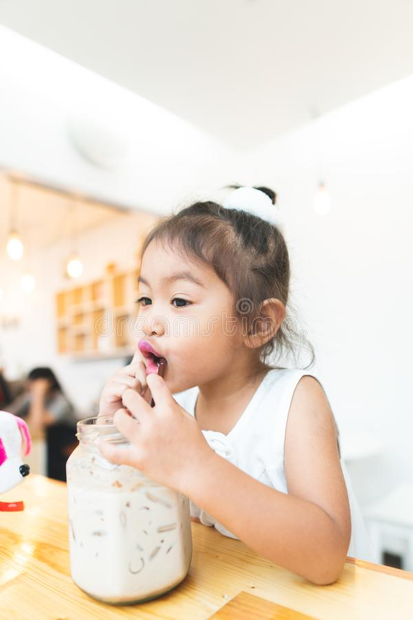 Asian little girl Drinking happy cocoa happily stock images