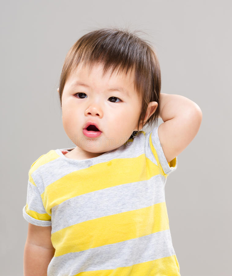 Asian little girl feeling confuse. With gray background royalty free stock photo