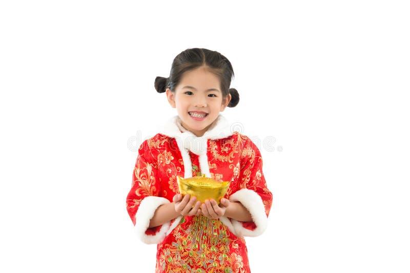 Asian little girl holding gold ingot money royalty free stock image